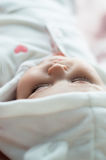Sleeping baby in white hood Stock Photos