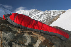 Sleeping bag. Mountaineers equipment - Sleeping bag in the mountain landscape Royalty Free Stock Photos