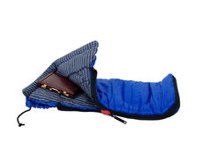 Sleeping Bag and briefcase. Sleeping bag used to keep warm on camping trips, Burgandy leather Briefcase used to carry items to the office Stock Images
