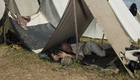 Sleeping between battles. A soldier sleeps in tent city between battles at the 150th anniversary of the battle of Gettysburg, Pennsylvania Stock Photography