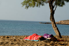 SLEEPING ON THE BEACH. 2 people sleeping on the beach Royalty Free Stock Images