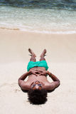 Sleeping on beach Stock Image