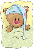 Sleeping Bear. Cute Cartoon Sleeping Teddy Bear with a cap in a bed Royalty Free Stock Images