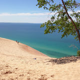 Sleeping Bear Dunes National Lakeshore. Two men standing on the dune at Sleeping Bear Dunes, Michigan, from a Pierce Stocking Drive turnout Stock Image