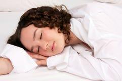 Sleeping beautiful young woman Stock Image