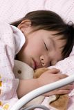 Sleeping Beauty 1. A young girl sleeping with her favorite stuffed animal... bunny Royalty Free Stock Photography
