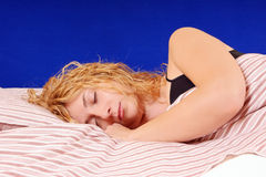 Sleeping beauty. Close-up of a beautiful blond young girl sleeping Royalty Free Stock Photography
