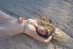 Sleeping Beauty. Woman lying in dry river run in a beautiful gown... dream Savasana, unawakened potential,for realizationeers Stock Photos