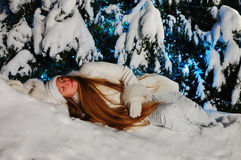 Sleeping beauty. Girl sleeping in the winter forest royalty free stock images