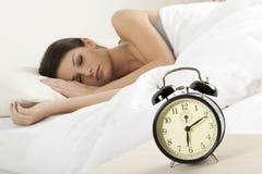 Sleeping beauty. Beautiful young woman sleeping in her bad Royalty Free Stock Image