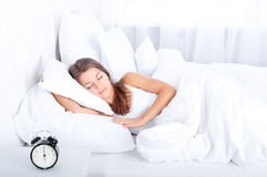 Sleeping beauty. Bedtime collection: woman sleeping in bed Stock Image