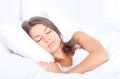 Sleeping beauty. Bedtime collection: woman sleeping in bed Stock Photography