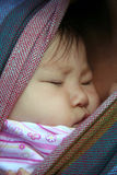 Sleeping Beauty. Sleeping Baby close to mommy's chest Royalty Free Stock Photo