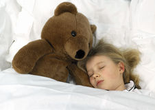 Sleeping beauty. Girl sleeping in the arms of her teddybear Stock Photo