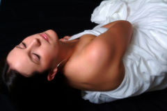 Sleeping Beauty. Colour portrait of female reclining with eyes closed Stock Photos