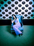 Sleeping Beauty. A glamorous young woman sleeping on a beautiful chair in a luxurious house Stock Photography