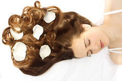 Sleeping beauty. Woman with flowers in her hair Stock Image