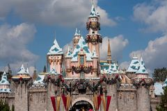 Sleeping Beauty Castle at Disneyland decorated for Christmas. Sleeping Beauty's Castle as decorated for Christmas at Disneyland, California. Blue sky with clouds royalty free stock photo