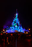 Sleeping Beauty Castle , the symbol of Disneyland Paris at night with a view of the main street stock image