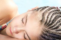 Sleeping beauty. Girl with many small plaited braids hairstyle. Sleeping beauty. Portrait of girl with many small plaited braids hairstyle. Summertime outdoors royalty free stock photo