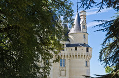 The sleeping beauty keeper. A tower of Ussé castle, seen from the chapel and framed by trees Stock Photos