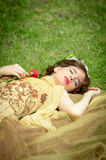 SLEEPING BEAUTY lying on the forrest with a rose Stock Images