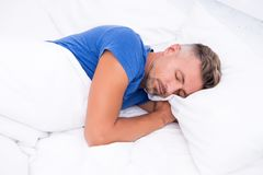 Sleeping beauty. Man handsome guy lay in bed. Get enough amount of sleep every night. Tips sleeping better. Bearded man. Sleeping face relaxing on pillow royalty free stock photos