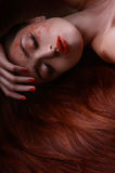Sleeping beauty. Portrait of beautiful women lying with her hand Royalty Free Stock Image