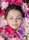 Sleeping Beauty: pretty woman among pink lilies Royalty Free Stock Photo