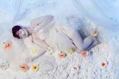 Sleeping beauty in white winter scenery Royalty Free Stock Photography
