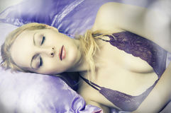 Sleeping beauty woman in silk Bed. Alone closeup Stock Photography