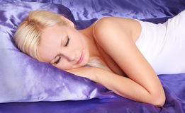 Sleeping beauty woman in silk bed Stock Image