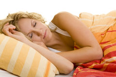 Sleeping in bed. Young blonde woman sleeping in her bed royalty free stock photos