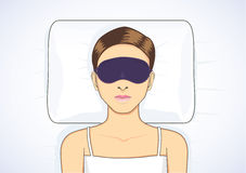 Sleeping in bed with eye mask Stock Image