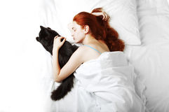 Sleeping on the bed girl Royalty Free Stock Image