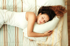 Sleeping on the Bed Royalty Free Stock Image