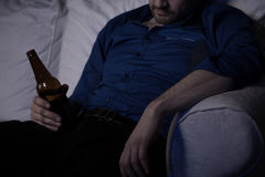 Sleeping with beer Royalty Free Stock Photography
