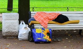 Sleeping on a bench homeless royalty free stock photos