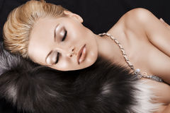 Sleeping blonde beauty on fur Stock Photo