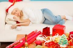 Sleeping blonde woman in santa hat Royalty Free Stock Photos