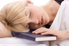 Sleeping with book Stock Images
