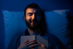 Sleeping with a Book Stock Photo