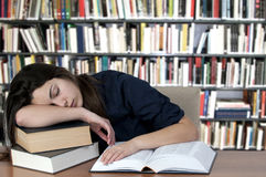 Sleeping on the books. Tired teenager, sleeping on the books Royalty Free Stock Images