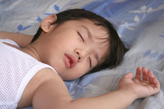 Sleeping boy. Boy sleeping with white singlet Royalty Free Stock Image