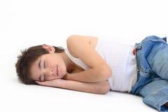 Sleeping boy. Male teenager pretending sleep isolated Stock Image