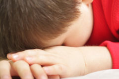 Sleeping boy. Boy in red sleeping focus on face Royalty Free Stock Photo