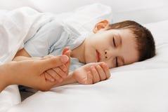 The sleeping boy Stock Photos
