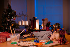 Sleeping boy baking Christmas cookies Royalty Free Stock Photos