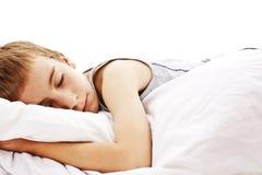 Sleeping boy in bed Stock Photos