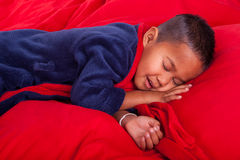 Sleeping boy in bed Royalty Free Stock Images